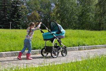 little girl walking with stroller alone