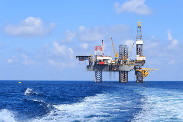 Wall Mural - Offshore Jack Up Drilling Rig Over The Production Platform