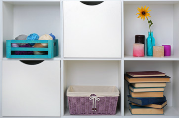 Beautiful white shelves with different home objects