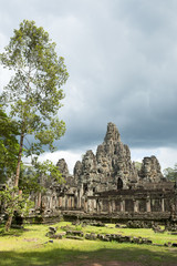 Angkor Temple of Bayon with surrounding greenery in the Angkor Thom complex