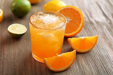 Glass of orange juice on wooden table, closeup