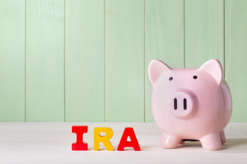 IRA theme with wood block letters and piggy bank