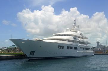 White Mega Yacht Moored at the Cruise Ship port in Nassau,Bahamas