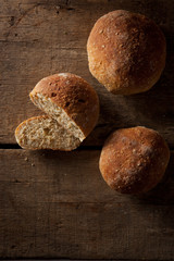 loaf of fresh bread on wooden background