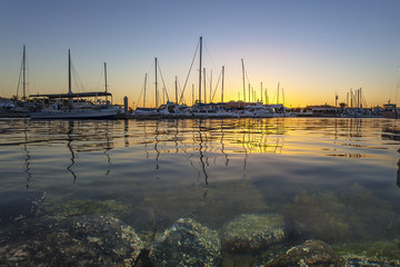 The Setting behind the Floating / As the sun goes down in the background of the Marina at Pt. Lincoln, South Australia.