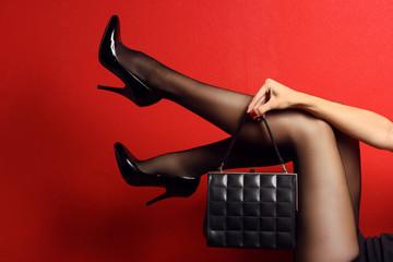 Wall Mural - Woman sexy legs with handbag.