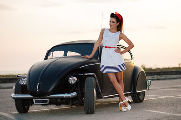 Beautiful pin-up with vintage car
