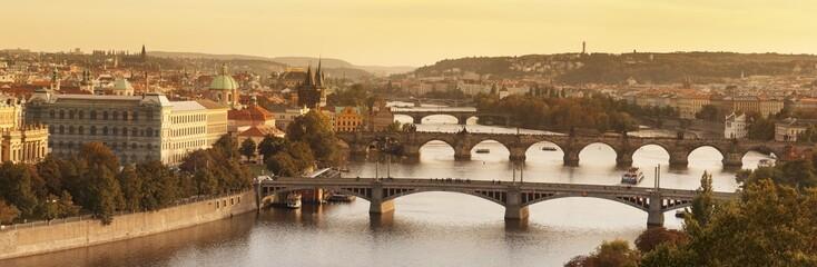Bridges over the Vltava River including Charles Bridge, UNESCO World Heritage Site, and the Old Town Bridge Tower at sunset, Prague, Bohemia, Czech Republic, Europe