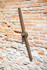 Restoration of the facade of an old italian masonry building with a anchor plate