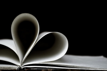 Heart shaped book pages, dark background