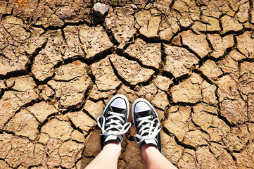 Girl standing on a dried earth