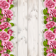 Wooden background with pink roses