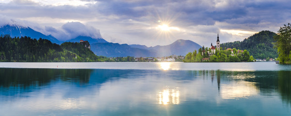 Lake Bled at sunrise with Church on Lake Bled Island and Bled Castle