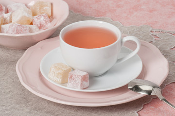 Assorted Turkish Delight. Cup Of Fruit Tea. Natural Linen Napkin
