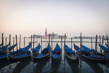 Gondolas moored on the Lagoon, San Giorgio Maggiore beyond, Riva degli Schiavoni, Venice, UNESCO World Heritage Site, Veneto, Italy, Europe