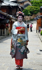 Maiko walking in Kyoto's street, Japan