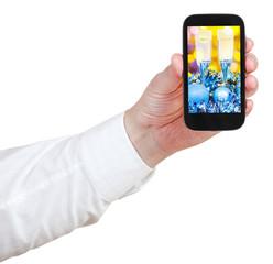 businessman holds handphone with Xmas still life
