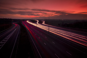 M25 motorway light trails at Dartford Crossing under dramatic sky, Kent, England, United Kingdom, Europe