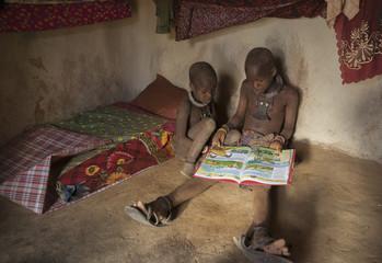 Himba children reading, Kaokoland, Namibia, Africa