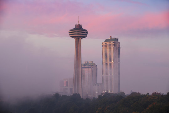 Mist from Horseshoe Falls swirling in front of Skylon Tower at dawn, Niagara Falls, Niagara, border of New York State and Ontario, Canada