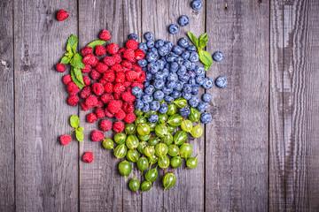 Set of summer berries - raspberries,  blueberries, gooseberries