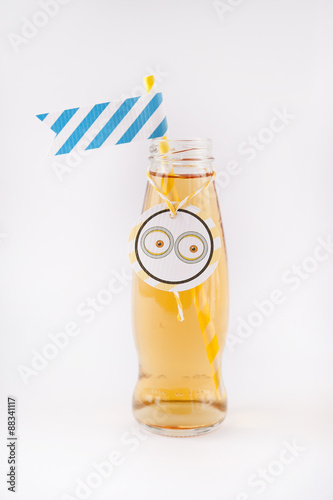 apple juice in a bottle with a flag and decorations