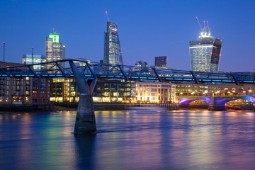 River Thames, Millennium Bridge and City of London skyline at dusk, London, England, United Kingdom, Europe