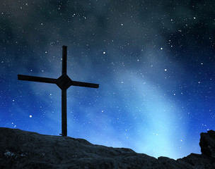 Top Cross silhouette in the night sky.