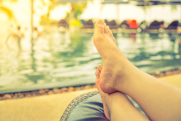 Female legs in the swimming pool water  ( Filtered image process