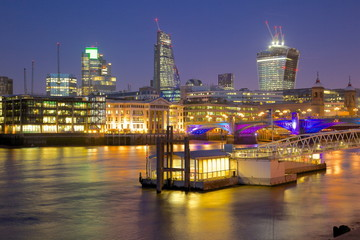 River Thames and City of London skyline at dusk, London, England, United Kingdom, Europe
