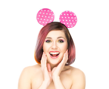 Beautiful surprised woman in mickey mouse ears.