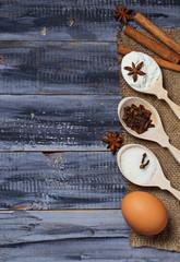 Ingredients for baking - egg, flour, sugar, anise, cinnamon