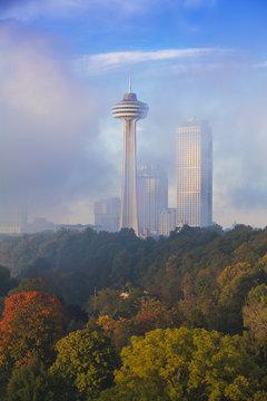 Mist from Horseshoe Falls swirling in front of Skylon Tower at dawn, Niagara Falls, Niagara, Ontario, Canada