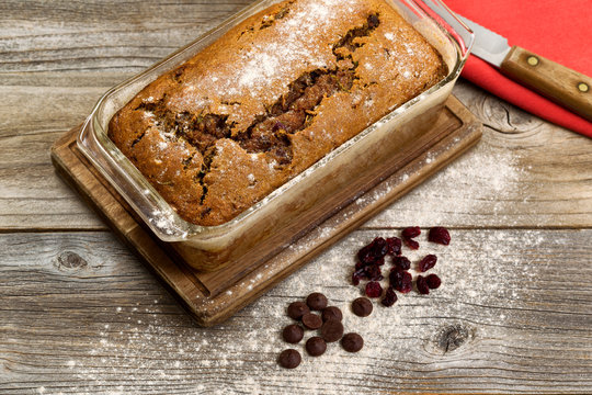 Freshly baked zucchini bread on rustic wooden boards