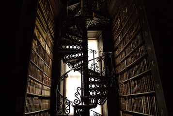 Spiral Staircase in an old Library of Books
