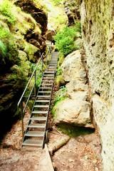 Ladder stair climbing on mountain via ferrata