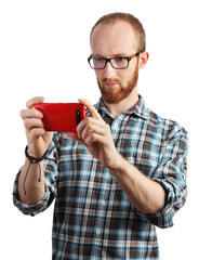 Image of man taking pictures with his smartphone isolated on whi