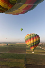 Hot air balloons flying over fields near Luxor, Egypt, North Africa, Africa