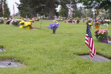 american flag on veteran graveside on memorial day