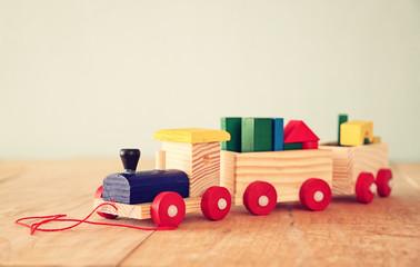 Wooden toy train over wooden floor. selective focus