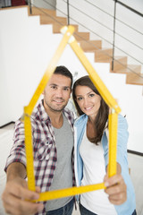 young couple happy in a new house