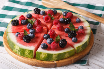 Watermelon with raspberries and blueberries close-up. Horizontal