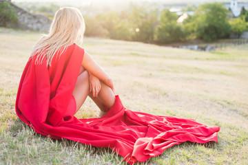Resting superhero, blonde wonderwoman posing outdoor