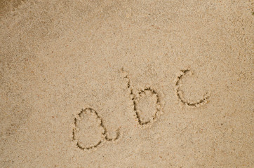 abc letters on sand