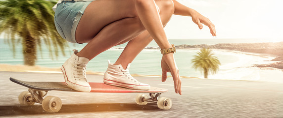 Girl cruising with her longboard