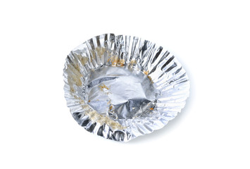 empty aluminium foil with crumb on white background