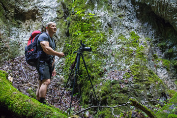 Photographer taking photos in a canyon