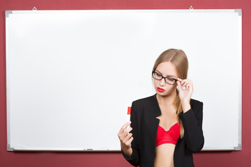girl with glasses and a bra on a background of white board