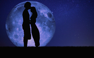 Night kiss under the moonlight.