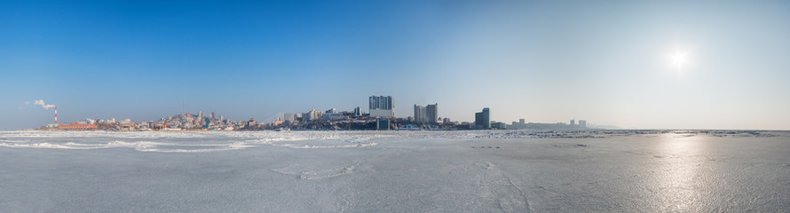 Vladivostok cityscape, day. Winter. View of the city from the Sea of Japan.